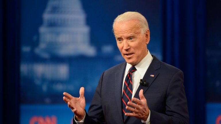 Don't play 'tough guy' with COVID-19, Biden warns Trump