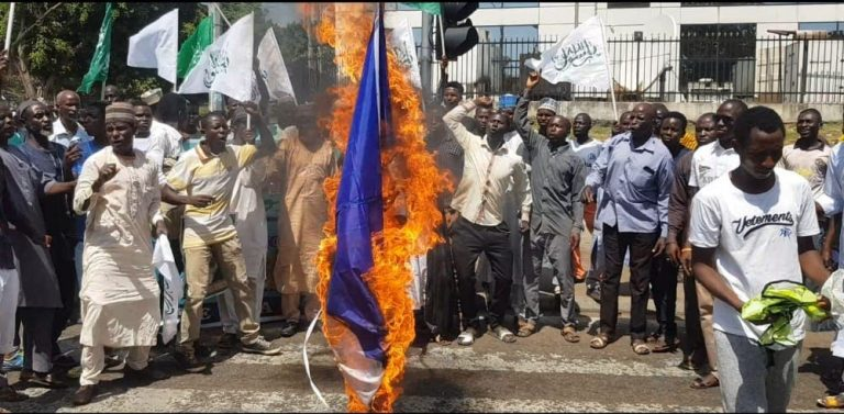 Shi'ites burn French flag in Abuja over Macron's 'controversial' comment