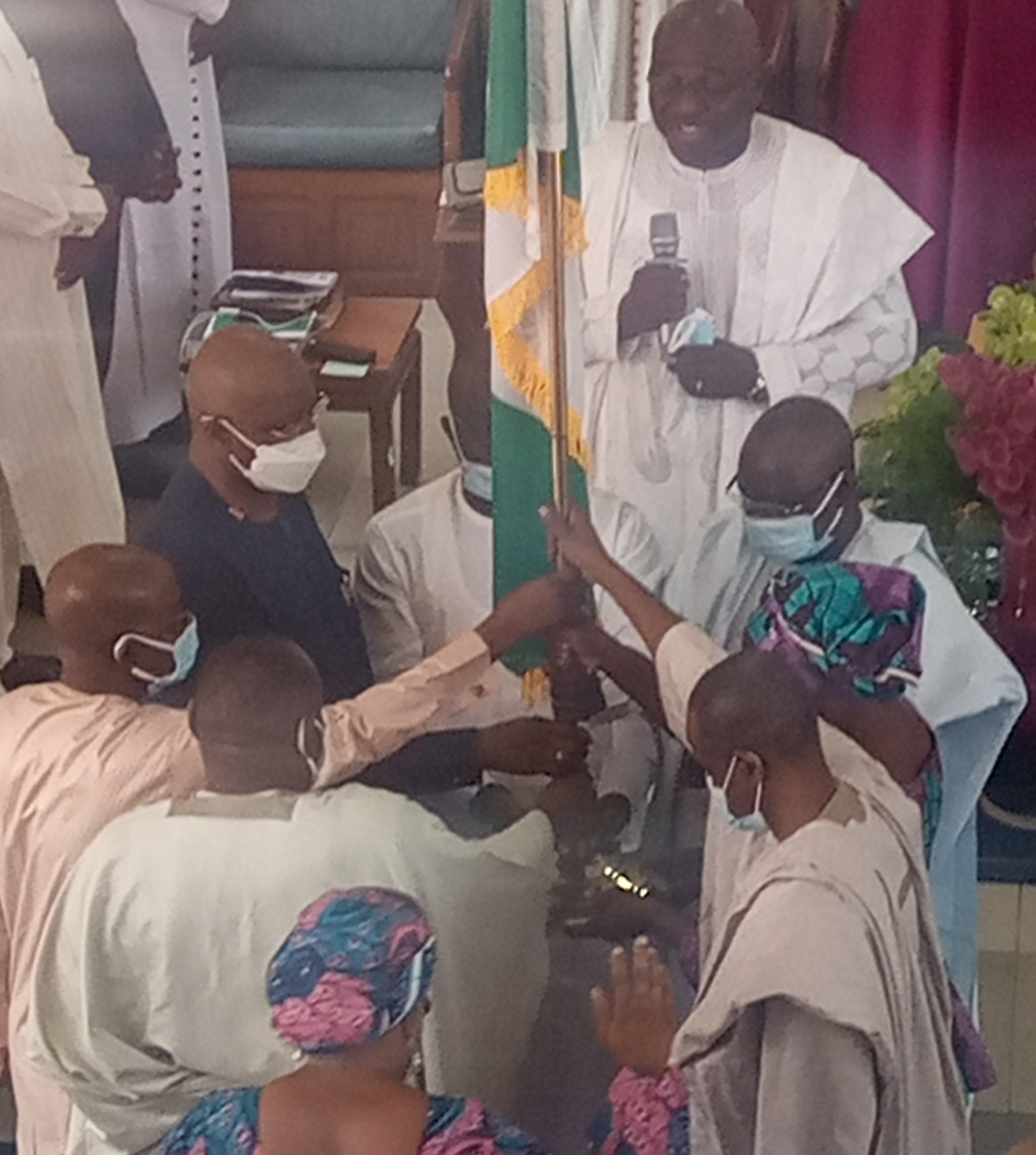 SGF: APC, PDP Members in Adamawa lift up Nigerian flag and pray for the unity of the nation